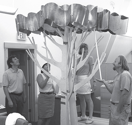 Members of the Environmental Exhibit Collaborative (EEC) working with prototypes during a development meeting for the traveling exhibition Tree Houses. Photo by Don Biehl, courtesy of Ecotarium, Worcester, MA.